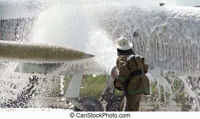 Man washing plane - Man in coveralls washing plane