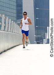 Asian male runner - Asian male jogging in day with...