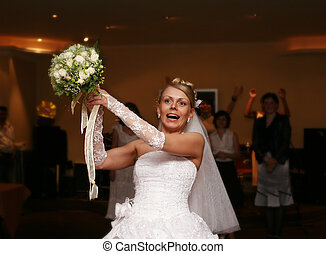 Wedding bouquet - The bride throws a wedding bouquet to the...