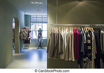 inside of boutique - detail of fashion shop with clothes