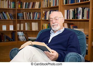 The Pleasure of Reading - Handsome senior man relaxing with...