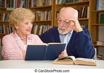 Read This, Honey - Senior woman at the library, showing her...