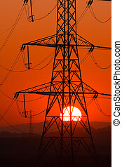sun thru pylon - Setting Sun seen through an electricity...