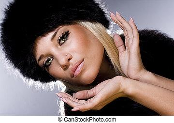 The beautiful blonde in a fur cap