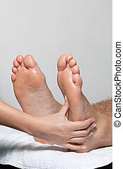 Foot Massage In Spa - Feet being massaged by female masseuse...