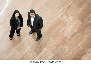 Indian business man and woman looking up - Two Indian...