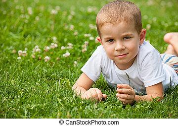Summer dreams of a little boy - A thoughtful little boy in...