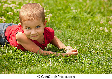 Summer dreams of a child - A cheerful little boy in red...