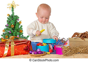 Happy baby playing with a Christmas gift - Happy little baby...