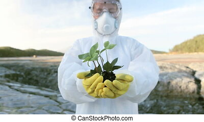 Showing growth - Chemical engineer showing a small new plant...