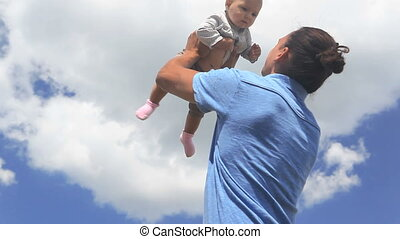 Fatherhood  - Happy father spinning his baby at summertime