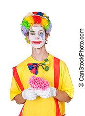 Clown holding pink flower