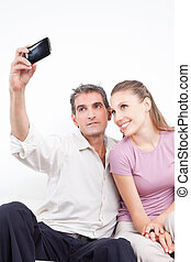Couple Taking Self Portrait - Lovely couple taking self...