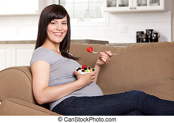 Pregnant Woman Eating Healthy Snack - Happy pregnant woman...
