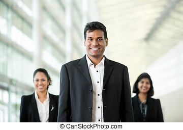 Happy Indian businessman with colleagues. - Handsome Indian...