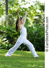 Woman performing yoga - Woman in white Performing yoga in...