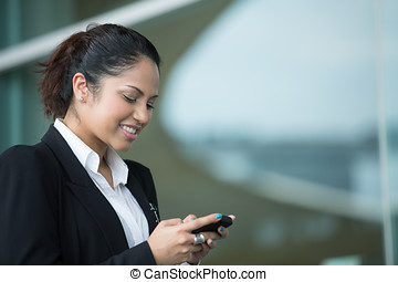 Indian business woman using mobile phone. - Portrait of an...