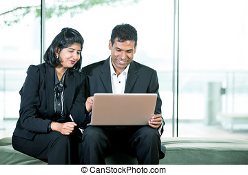 Indian Business colleagues. - Indian Business man and woman...