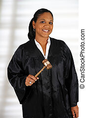 Judge - Woman judge standing up in the court room