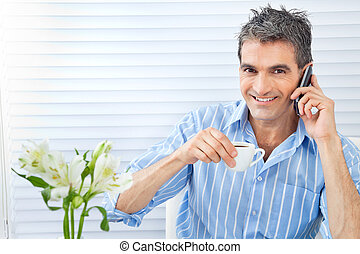 Happy Man Receiving Phone Call - Portrait of handsome middle...