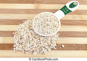 Serving of Oatmeal - Serving of dry Oatmeal in a measuring...