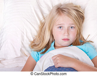 sick girl laying in bed - sick gril laying in bed with a sad...