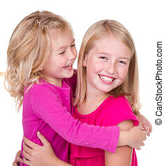 sisters hugging and looking at each other isolated on white