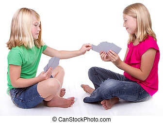 sisters or friends playing cards