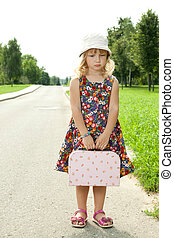 Little girl standing on roadside - Little cute girl standing...