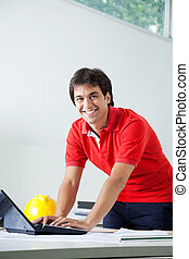 Male Architect Using Laptop - Portrait of young male...
