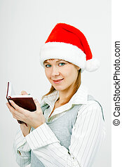 girl with a notebook in santa hat