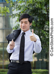 Happy business team giving thumbs up. - Happy Asian business...