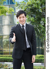 Asian business man ready to shake hands - Happy Asian...