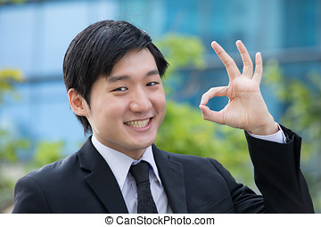 Asian business man gesturing okay. - Portrait of an Asian...