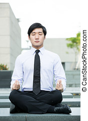 Asian business man doing Yoga. - Asian business man...