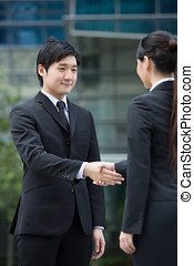 Happy Business people shaking hands - Asian business man and...