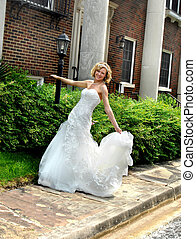 Animated Bride - Beautiful young bride dances on the...