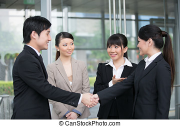 Business people shaking hands - Asian business man and woman...