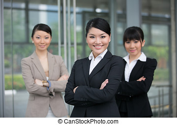 Asian business team - Three happy Asian business women...
