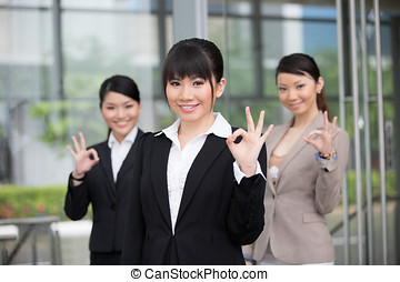 Happy Asian business team - Three happy Asian business woman...