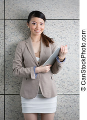 Asian Business woman using an Digital Tablet. - Asian...
