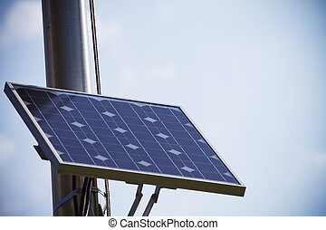 Solar Panel - Solar panel mounted on a flag pole with copy...