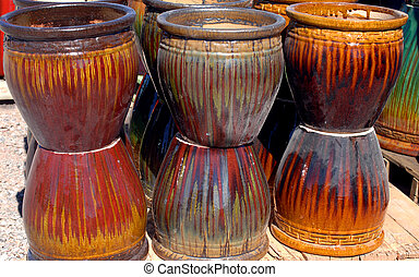 Big Pots in earth tones - Stacks of earth tone colored...