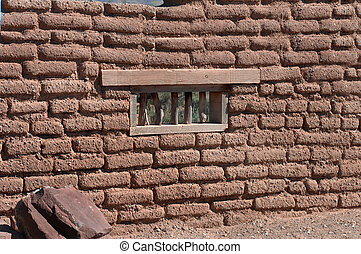 Adobe wall with window