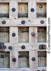 Aging Door - Rustic and weathered, wooden door has rusty and...