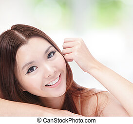 portrait of attractive woman happy smiling and hand touch...