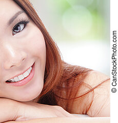 half face young woman smile with health teeth - portrait of...