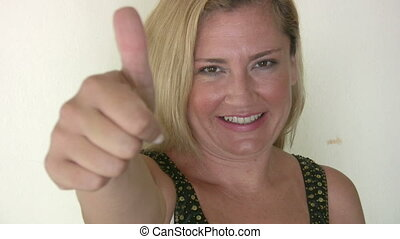 Happy woman showing a thumb up