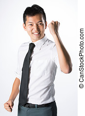 Asian businessman celebrating. - Young Asian business man...