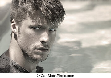 Handsome man face - Portrait of a handsome young man against...